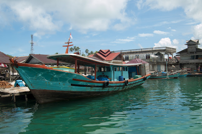 traditional wooden boat in Balai